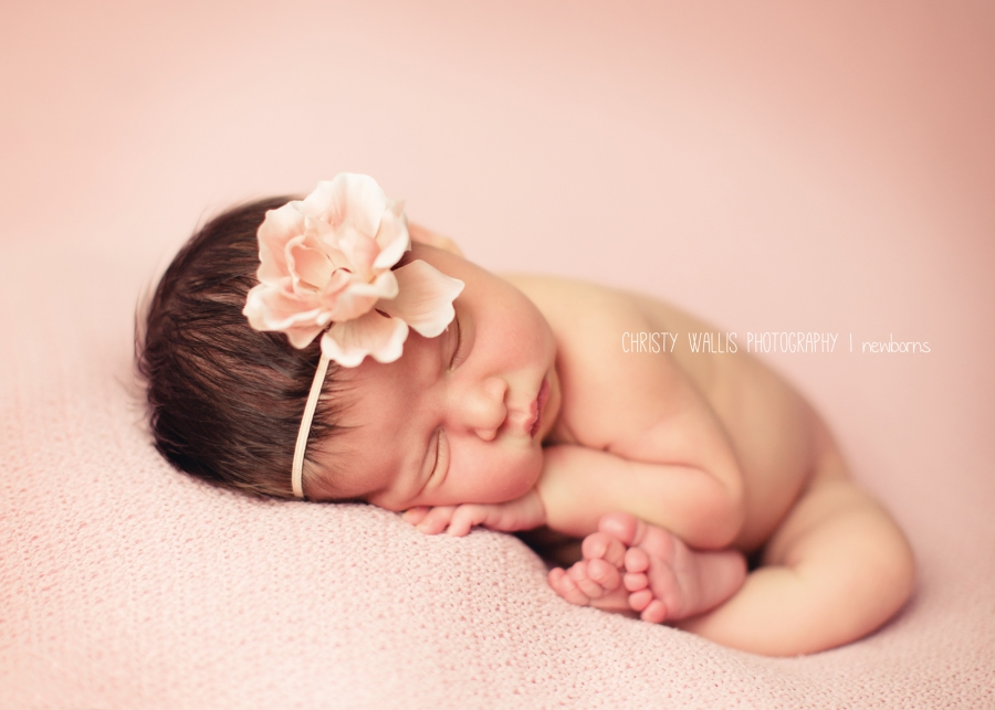So perfectshe was and slept through the whole session definitely makes my job as a newborn photographer like a dream san diego baby photographer ·
