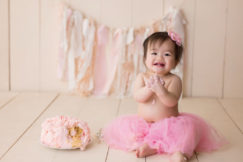 One Year Portraits by San Diego Baby Photographer Christy Wallis Photography with a cake smash session.